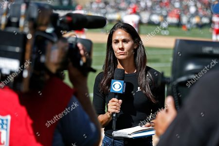 CBS reporter Tracy Wolfson during the second half of an NFL football game between the Oakland Raiders and the Kansas City Chiefs, in Oakland, Calif