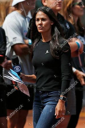 CBS reporter Tracy Wolfson on the sidelines before an NFL football game between the Oakland Raiders and the Kansas City Chiefs, in Oakland, Calif