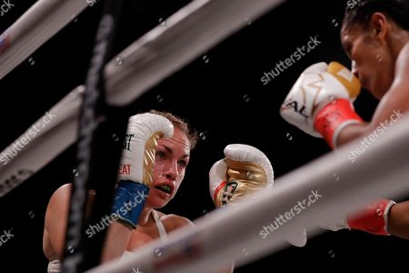 Heather Hardy, left, during the second round of a WBO world female featherweight championship boxing match against Amanda Serrano, in New York. Serrano won the fight