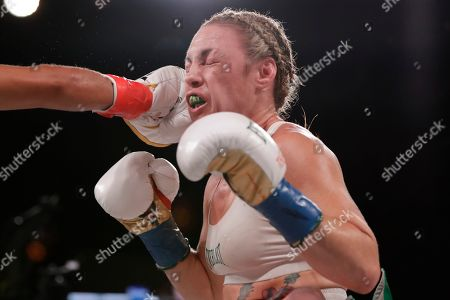 Heather Hardy during the fifth round of a WBO world female featherweight championship boxing match against Amanda Serrano, in New York. Serrano won the fight