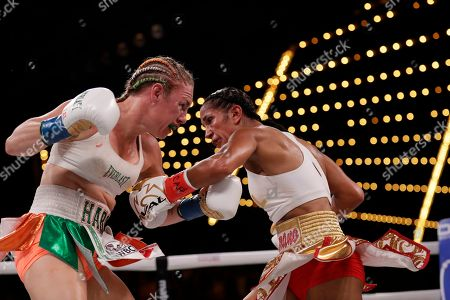 Heather Hardy during the fifth round of a WBO world female featherweight championship boxing match against Amanda Serrano, right, in New York. Serrano won the fight