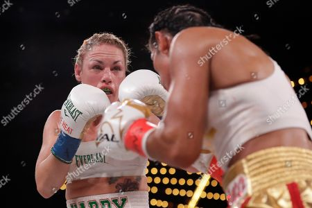 Heather Hardy during the fifth round of a WBO world female featherweight championship boxing match against Heather Hardy, in New York. Serrano won the fight