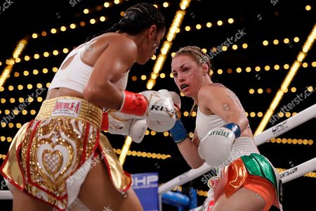 Stock Image of Amanda Serrano, left, fights Heather Hardy during the third round of a WBO world female featherweight championship boxing match, in New York. Serrano won the fight