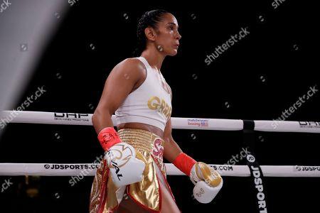 Amanda Serrano waits for the start of a WBO world female featherweight championship boxing match against Heather Hardy, in New York. Serrano won the fight