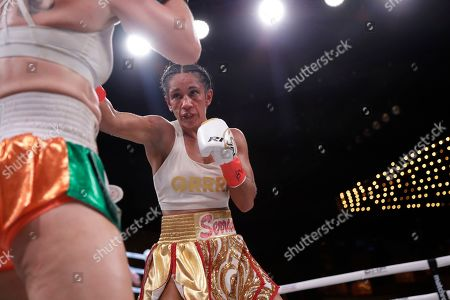 Stock Picture of Amanda Serrano fights Heather Hardy during the first round of a WBO world female featherweight championship boxing match, in New York. Serrano won the fight