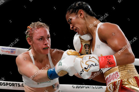 Heather Hardy, left, punches Amanda Serrano during the second round of a WBO world female featherweight championship boxing match, in New York. Serrano won the fight