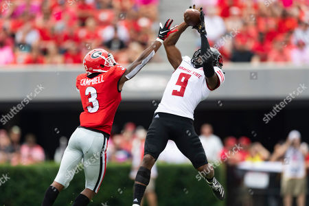 Arkansas State wide receiver Jonathan Adams Jr. (9) leaps to make a catch while defended by Georgia defensive back Tyson Campbell (3) during an NCAA football game on in Athens, Ga
