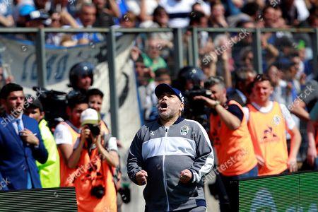 Gimnasia y Esgrima head coach Diego Maradona, celebrates a goal of his team during a game before Racing Club, at the Juan Carmelo Zerillo Stadium, in La Plata, Argentina, 15 September 2019.