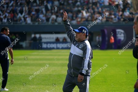 Gimnasia y Esgrima head coach Diego Maradona, waves fans during a game before Racing Club, at the Juan Carmelo Zerillo Stadium, in La Plata, Argentina, 15 September 2019.