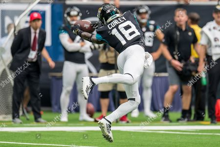 Jacksonville Jaguars wide receiver Chris Conley (18) attempts to make a catch during the 4th quarter of an NFL football game between the Jacksonville Jaguars and the Houston Texans at NRG Stadium in Houston, TX. The Texans won the game 13 to 12