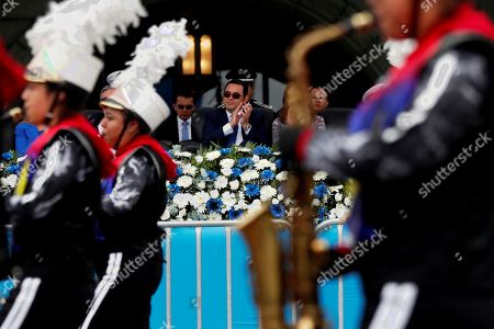 Guatemalan President Jimmy Morales watches the school band parade of the celebration of Independence, in Guatemala City, Guatemala, 15 September 2019. Guatemala continued this Sunday the commemoration of its 198 years of independence from the Spanish crown with a large parade of military schools and educational centers.