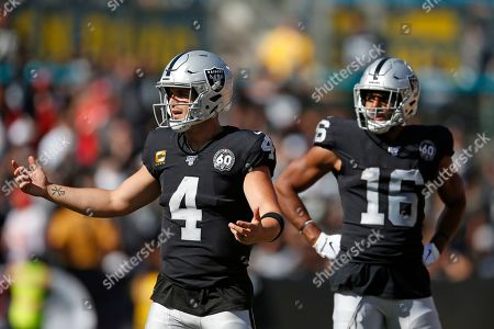 Oakland Raiders quarterback Derek Carr (4) reacts after a play as wide receiver Tyrell Williams (16) looks on during the second half of an NFL football game against the Kansas City Chiefs, in Oakland, Calif