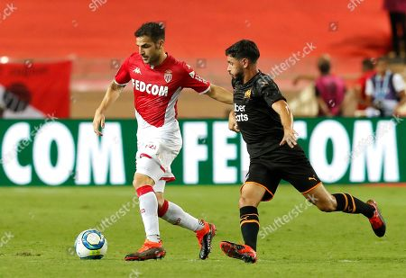 Cesc Fabregas (L) of AS Monaco and Morgan Sanson (R) of Olympique Marseille in action during the French Ligue 1 soccer match, AS Monaco vs Olympique Marseille, at Stade Louis II, in Monaco, 15 September 2019.
