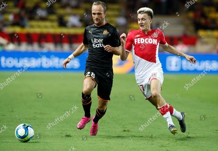 Aleksandr Golovin (R) of AS Monaco and Valere Germain (L) of Olympique Marseille in action during the French Ligue 1 soccer match, AS Monaco vs Olympique Marseille, at Stade Louis II, in Monaco, 15 September 2019.