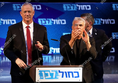 Leaders of the Blue and White political alliance, former chief of staff of the Israeli army, Benny Gantz (L) and former finance minister Yair Lapid (R) speak to their supporters during the final stage of his election campaign in Tel Aviv, Israel, 15 September 2019. Israeli legislative elections will be held on 17 September.