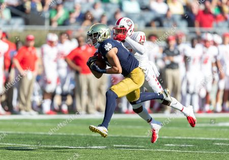 Stock Image of Notre Dame wide receiver Braden Lenzy (25) catches the ball as New Mexico defensive back Michael LoVett III (14) defends during NCAA football game action between the New Mexico Lobos and the Notre Dame Fighting Irish at Notre Dame Stadium in South Bend, Indiana. Notre Dame defeated New Mexico 66-14