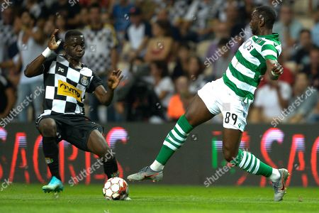 Boavista's player Yaw Ackah (L) vies for the ball with Sporting's player Yannick Bolasie during their Portuguese First League soccer match, held at Bessa Sec XXI ?stadium in Porto, Portugal, 15 September 2019.