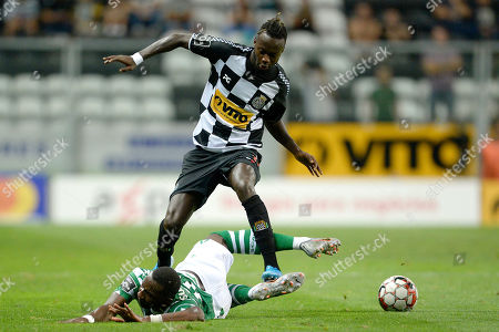 Boavista's player Yusupha Njie (up) vies for the ball with Sporting's player Yannick Bolasie during their Portuguese First League soccer match, held at Bessa Sec XXI ?stadium in Porto, Portugal, 15 September 2019.