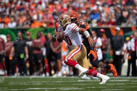 San Francisco 49ers quarterback Jimmy Garoppolo (10) is pursued by Cincinnati Bengals defensive end Carlos Dunlap (96) during NFL football game action between the San Francisco 49ers and the Cincinnati Bengals at Paul Brown Stadium on , in Cincinnati, OH