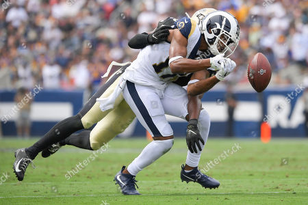 New Orleans Saints cornerback Eli Apple, back, breaks up a pass intended for Los Angeles Rams wide receiver Robert Woods during the first half of an NFL football game, in Los Angeles