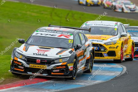 Stock Photo of Dan CAMMISH (GBR)(#27) of Halfords Yuasa Racing exits chicane followed by Tom CHILTON (GBR)(#3) of Team Shredded Wheat Racing with Gallagher during Round 22 of the 2019 British Touring Car Championship at Knockhill Racing Circuit, Dunfermline