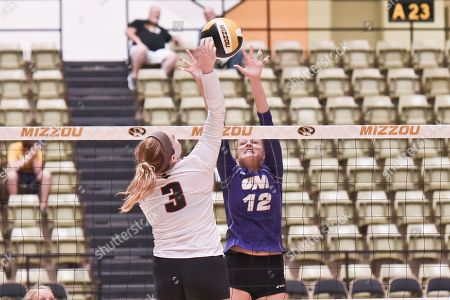 Austin Peay outside hitter Brooke Moore (3) tries to hit past the block attempt of University of Northern Iowa middle hitter Kate Busswitz (12) during part of the Mizzou Invitational tournament where University of Northern Iowa played Austin Peay, held at The Hearnes Center in Columbia, MO Richard Ulreich/CSM