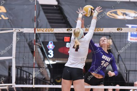 Austin Peay outside hitter/defensive specialist Chloe Stitt (4) is able to block the hit of University of Northern Iowa middle hitter Kate Busswitz (12) during part of the Mizzou Invitational tournament where University of Northern Iowa played Austin Peay, held at The Hearnes Center in Columbia, MO Richard Ulreich/CSM