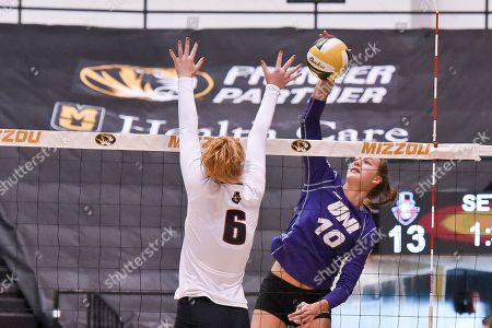 University of Northern Iowa middle hitter Emily Holterhaus (10) drives the ball past the block attempt of Austin Peay right side hitter Tegan Seyring (6) during part of the Mizzou Invitational tournament where University of Northern Iowa played Austin Peay, held at The Hearnes Center in Columbia, MO Richard Ulreich/CSM