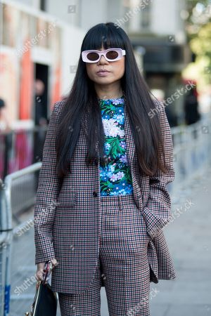 Street Style Image shows ex Elle China Fashion Editor, now Stylist and influencer, Leaf Greener arriving to attend a show