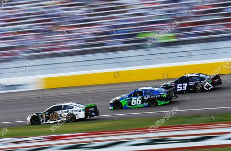 Aric Almirola (10), Timmy Hill (66) and Josh Bilicki (53) drive during a NASCAR Cup Series auto race at the Las Vegas Motor Speedway on