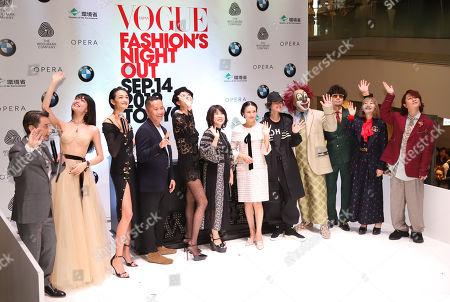 (L-R) Chris Peppler, Rina Fukushi, Ai Tominaga, Phillip Lim, Hikari Mori, Mitsuko Wsatanabe, Ko Shibasaki, Shishidokavka and members of the pop group Sekai no Owari pose for photo at the opening ceremony