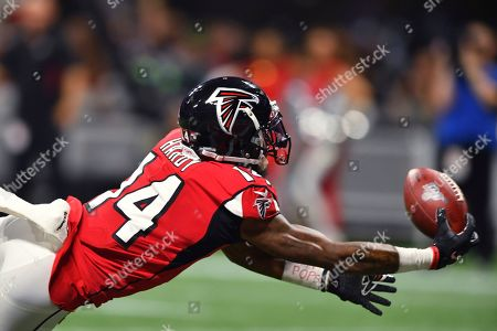 Atlanta Falcons wide receiver Justin Hardy (14) misses the catch against the Philadelphia Eagles during the first half of an NFL football game, in Atlanta