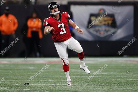 Atlanta Falcons kicker Matt Bryant (3) watches his kick against the Philadelphia Eagles during the first half of an NFL football game, in Atlanta