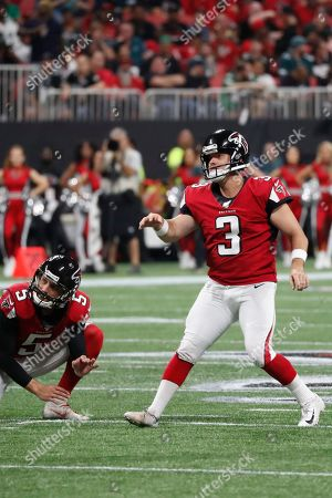 Atlanta Falcons kicker Matt Bryant (3) watc hes his point after kick during the first half of an NFL football game against the Philadelphia Eagles, in Atlanta