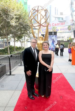 Bernard Telsey, left, and guest arrive at night two of the Television Academy's 2019 Creative Arts Emmy Awards, at the Microsoft Theater in Los Angeles
