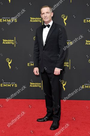 Marc Evan Jackson arrives at night two of the Creative Arts Emmy Awards, at the Microsoft Theater in Los Angeles