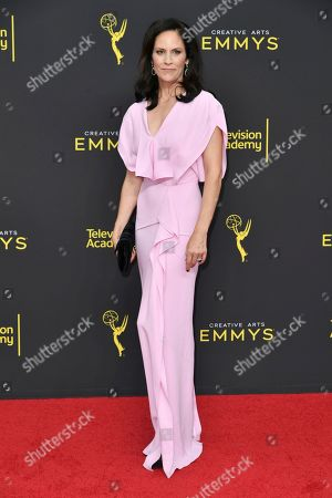 Annabeth Gish arrives at night two of the Creative Arts Emmy Awards, at the Microsoft Theater in Los Angeles