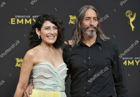 Lisa Edelstein, Robert Russell. Lisa Edelstein, left, and Robert Russell arrive at night two of the Creative Arts Emmy Awards, at the Microsoft Theater in Los Angeles