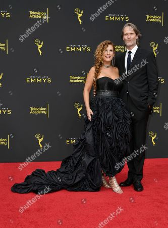 Stock Photo of Sherri Berman Laurence, Michael Laurence. Sherri Berman Laurence, left, and Michael Laurence arrive at night two of the Creative Arts Emmy Awards, at the Microsoft Theater in Los Angeles