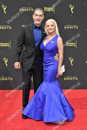 Stock Image of Julie Michaels, Peewee Piemonte. Peewee Piemonte, left, and Julie Michaels arrive at night two of the Creative Arts Emmy Awards, at the Microsoft Theater in Los Angeles
