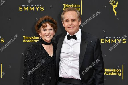 Martha Sue Cumming, left, and Peter MacNicol arrive at night two of the Creative Arts Emmy Awards, at the Microsoft Theater in Los Angeles