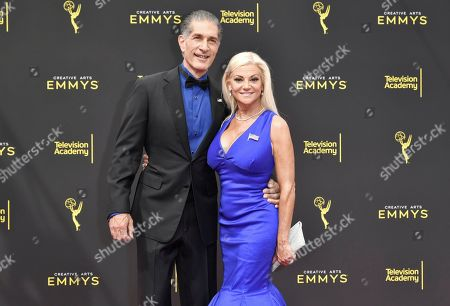 Stock Picture of Julie Michaels, Peewee Piemonte. Peewee Piemonte, left, and Julie Michaels arrive at night two of the Creative Arts Emmy Awards, at the Microsoft Theater in Los Angeles