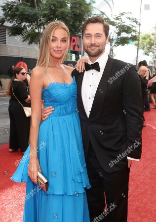 Stock Image of Elizabeth Turner, Ryan Eggold. Elizabeth Turner, left, and Ryan Eggold arrive at night two of the Television Academy's 2019 Creative Arts Emmy Awards, at the Microsoft Theater in Los Angeles