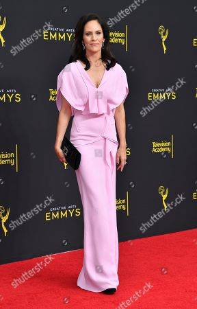 Annabeth Gish arrives at night two of the Television Academy's 2019 Creative Arts Emmy Awards, at the Microsoft Theater in Los Angeles