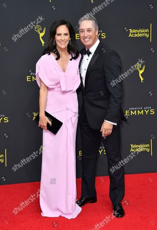 Annabeth Gish, Wade Allen. Annabeth Gish, left, and Wade Allen arrive at night two of the Television Academy's 2019 Creative Arts Emmy Awards, at the Microsoft Theater in Los Angeles