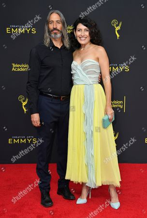 Stock Photo of Lisa Edelstein, Robert Russell. Robert Russell, left and Lisa Edelstein arrive at night two of the Television Academy's 2019 Creative Arts Emmy Awards, at the Microsoft Theater in Los Angeles