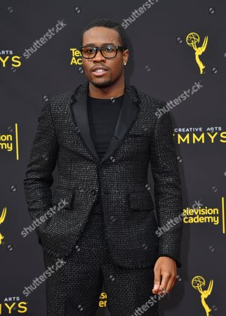 Shameik Moore arrives at night two of the Television Academy's 2019 Creative Arts Emmy Awards, at the Microsoft Theater in Los Angeles