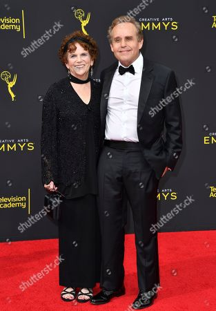 Peter MacNicol, Marsue MacNicol. Marsue MacNicol, left, and Peter MacNicol arrive at night two of the Television Academy's 2019 Creative Arts Emmy Awards, at the Microsoft Theater in Los Angeles