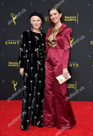 Stock Photo of Analucia McGorty, Lou Eyrich. Lou Eyrich, left, and Analucia McGorty arrive at night two of the Television Academy's 2019 Creative Arts Emmy Awards, at the Microsoft Theater in Los Angeles