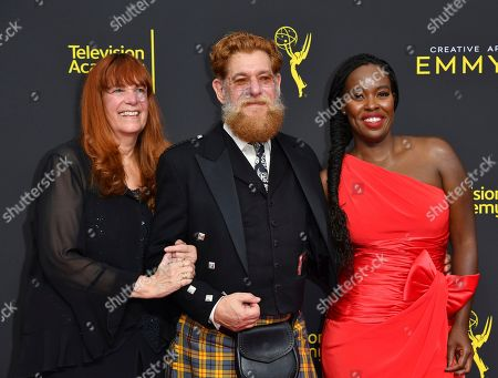 Barbara Hause, David Robinson, Ann Bryant. Barbara Hause, from left, David Robinson and Ann Bryant arrive at night two of the Television Academy's 2019 Creative Arts Emmy Awards, at the Microsoft Theater in Los Angeles